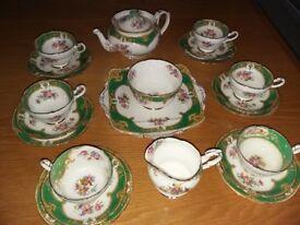 Vintage Bone China Tea Set inc. tea cups, saucer, milk jug, sugar bowl and teapot.