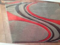 rug only 4 months old excellent condition with grey background red & black lines running length
