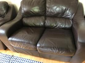 Two seats brown leather sofa