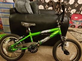 Green metalic avigo bmx bike.