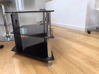 Black glass / chrome TV stand.