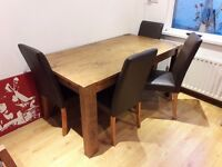 Extendable solid oak dining room table with 4 chairs