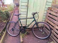 Raleigh Outland mountain bike 18 gears 19 inch frame 26 inch wheels v brakes