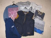 Boys clothes age 12 to 13, 2 sweatshirts, 2 T.Shirts, 1 Puffa jacket, 1 long sleeve top.