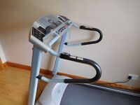 Horizon model electrically adjustable treadmill for sale.