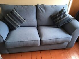 Light blue sofa bed, barely used, excellent condition.
