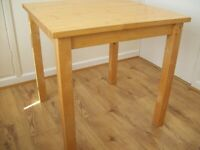Ikea small kitchen table. 74.5cm square. Some marks but sturdy two-seater. Legs removable
