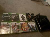 Xbox 360, 1 remote control & 7 free games