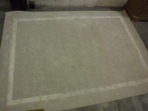 Large, ivory colour carpet. Feizy import & export. Hand tufted. Made in India
