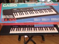 Casio CA-100. Electronic Musical Keyboard. 1991. Adjustable stand. Full working order.
