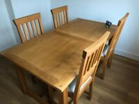 Laura Ashley extendable oak dining table & 4 chairs.. Perfect condition.