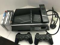 PlayStation 3 (PS3) with games and accessories