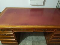 Antique style leather top desk with draws either side. 6ft by 3ft