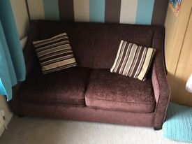Chocolate brown 2 seater sofa bed with matching stripy cushions