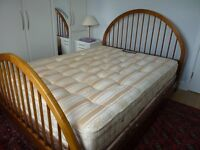 Wooden framed double bed with mattress
