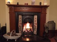 Cast iron fireplace insert and mantelpiece excellent condition.