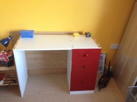 Children's wooden desk with drawers.
