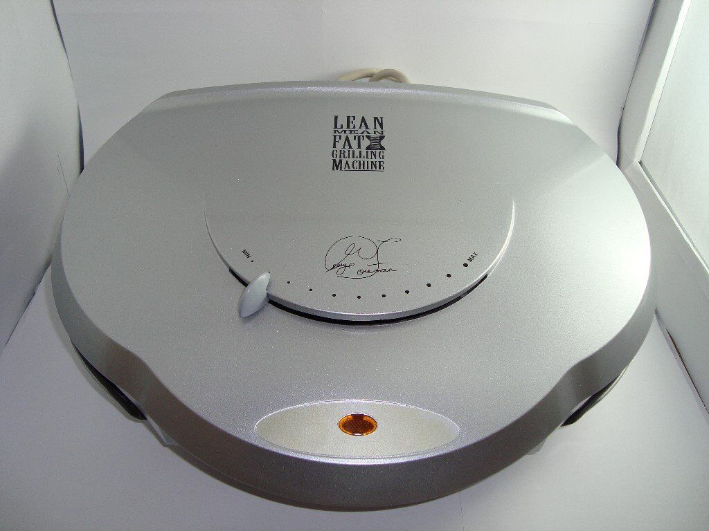 LARGE GEORGE FOREMAN GRILL ALMOST NEW CONDITION WITH UTENSILS AND INSTRUCTION BOOK