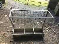 Hayrack and manger/feeder and trough/planter.