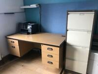 Office Desk, filing cabinet, whiteboard and blue noteboard