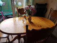 A real wood extendable oval dinning table