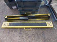Heavy duty metal saw horse folding in good order and ready to work padded tops