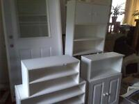 2 white cabinets and 3 smaller shelving units