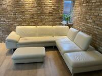White leather corner sofa and a matching footstool