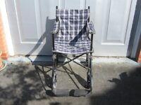 Used lightweight travel fabric wheelchair, no hand push grips.