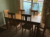 6ft solid oak extending table with six chairs