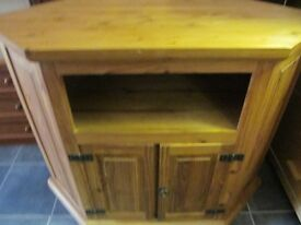 LARGE SOLID PINE TV UNIT IN VGC HAS HOLES CUT OUT IN THE BACK FOR WIRES ,