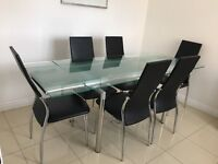 Large Glass Extending Dining table + 6 black chairs