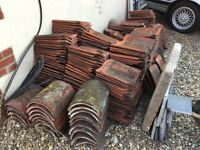 Old clay red pan tiles and ridge tiles