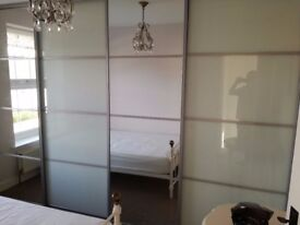 Sliding wardrobe doors - 2 mirrored and 2 opaque with track to fit all 4 doors