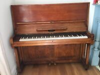 upright old piano, has been re-tuned but has been used!
