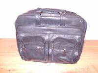 Esselte Travel Bag, Saturn ( Black leather on wheels ) ( never used )