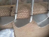 Wilson fat shaft irons.
