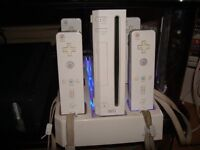 Nintendo Wii w/ Remotes, Charging Dock, 5 Games and Accessories