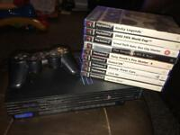 PS2 Console, controller, 8mb card & 9 games