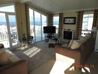 Quality Lodge (Private Sale). Site fees paid for year. Stunning Arran/sea- views. Beach 150 metres