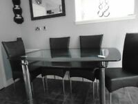Glass dining table . ( No chairs )