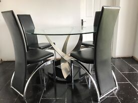 Modern Italian designer glass table and high back chairs