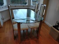 Round Clear Glass Extending Dining Table with 4 High Back Chrome Detail & Cream Faux Leather Chairs