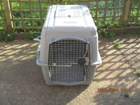 Fibreglass dog cage for home use or for transportation purposes