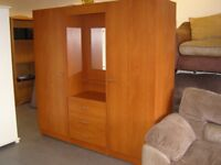 2 Wardrobes and Central Dresser with Mirror Drawers and Light. Great Condition and Quality