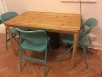 Solid pine dining table (120x75cm) + 3 chairs (great condition)
