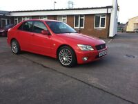 LEXUS IS200 SE .2003 red with black half leather trim.