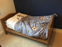 Cot bed with changing unit and storage drawer