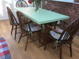 Large wooden table with six chairs