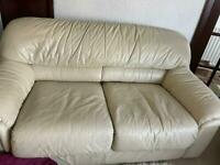 CREAM LEATHER SOFA AND TWO MATCHING CHAIRS.